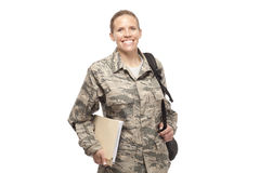 Happy female airman with books and bags Stock Image