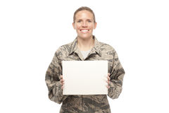 Happy female airman with placard Royalty Free Stock Photos