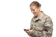 Happy female airman text messaging Royalty Free Stock Images
