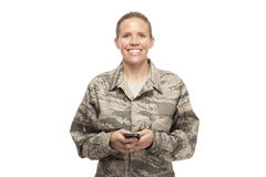Happy female airman text messaging Royalty Free Stock Photo