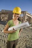 Happy Female Architect Holding Blueprint Royalty Free Stock Photo