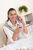 Happy female architect on the phone Royalty Free Stock Images