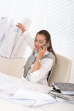 Happy female architect on the phone Stock Images