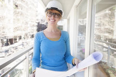 Happy female architect working Royalty Free Stock Photos