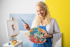 Happy female artist painting Royalty Free Stock Photography