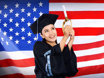 Happy female asian student with USA flag background Stock Photography