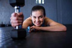 Happy female athlete holding dumbbell Royalty Free Stock Images
