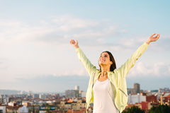 Happy female athlete on outdoor training raising arms Stock Image