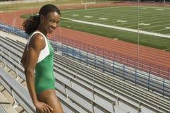 Happy Female Athlete In Stadium Royalty Free Stock Image