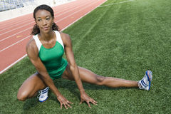 Happy Female Athlete Warming Up Stock Image