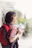 Happy female backpacker. In the city Stock Photo