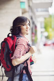 Happy female backpacker. In the city Stock Photos