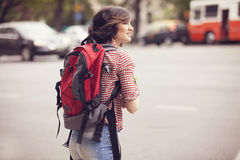 Happy female backpacker. Happy smiling female backpacker travelling Stock Photo