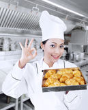 Happy baker with croissants Stock Image
