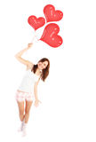 Happy female with balloons Royalty Free Stock Image