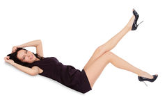 Happy female in black dress lie on the floor Stock Photos