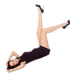 Happy female in black dress lie on the floor Royalty Free Stock Photography