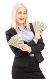 Happy female in black suit holding US dollars Stock Images