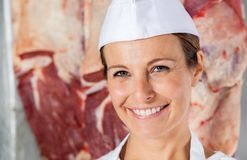 Happy Female Butcher In Shop Royalty Free Stock Image
