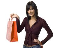 Happy female buyer. Young woman standing with shopping paper bags. Isolated on white in studio Stock Images