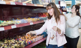 Happy female buyers selecting traditional candies Royalty Free Stock Image