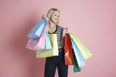 Happy Female Carrying Shopping Bags Stock Photo