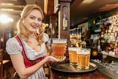 Happy female carryng beverage in boozer Royalty Free Stock Photo