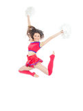 Happy female cheerleader dancer from cheerleading. Team jumping in mid air against white background Royalty Free Stock Photo