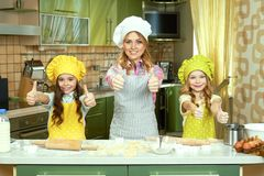 Happy female chef and children. Royalty Free Stock Photos