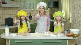 Happy female chef and children. stock video footage