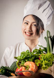 Happy Female Chef with Healthy Farm Vegetables Stock Photo