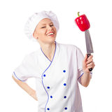 Happy female chef preparing to cook Royalty Free Stock Image