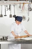 Happy Female Chef Rolling Dough Stock Image