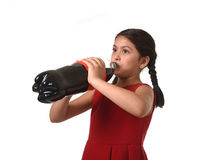 Happy female child holding big soda bottle against her face in crazy and over excited expression Stock Image