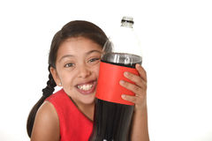Happy female child holding big soda bottle against her face in crazy and over excited expression Royalty Free Stock Images