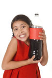 Happy female child holding big soda bottle against her face in crazy and over excited expression Royalty Free Stock Photo