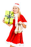 Happy female Christmas Santa with gift and shoes Stock Image