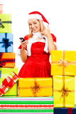 Happy female Christmas Santa on the phone Stock Photos