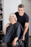 Happy Female Client And Hairdresser Stock Images