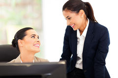 Happy female colleagues. In office royalty free stock images