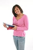 Happy Female College Student Holding Notebooks Stock Photo