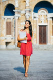 Happy female college student at university stock photography