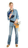 Happy Female Construction Worker With Drill And Tool Belt royalty free stock photos