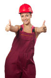 Happy female construction worker showing thumbs up Stock Photo