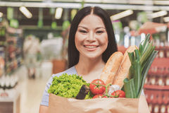 Happy female consumer keeping food royalty free stock photos