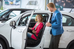 Happy female costumer at a showroom car Stock Image