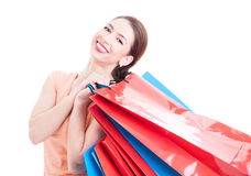Happy female customer holding many shopping bags and smiling Royalty Free Stock Photo