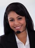 Happy female customer representative. Close-up Of Happy Young Female Customer Representative Stock Image