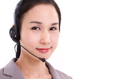 Happy female customer service executive face closeup with headse Royalty Free Stock Images