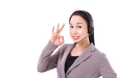 Happy female customer service executive giving ok hand gesture Stock Photo